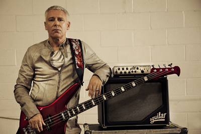 u2-bassist-adam-clayton-playing-aguilar-tone-hammer-500-amp-and-sl-112-cabinet.jpg